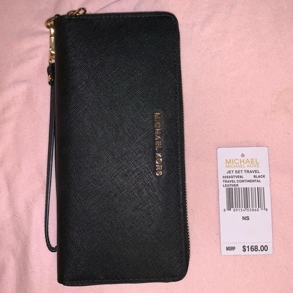 Michael Kors Handbags - Michael Kors Large Black Jet Set Travel Wallet